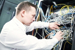 network engineer administrating in server room