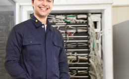Technician in front of a network rack
